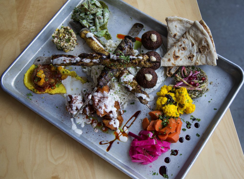 The All In, a large-format sharing plate with kabobs, mezze, spreads, pickles, sauces and Iraqi flatbread.