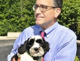 Jay Elias of Dyer-Lake Funeral Home in North Attleboro, Mass., holds 4-year-old Charlie.