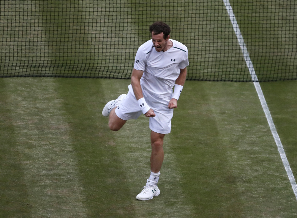 Andy Murray celebrates Friday after defeating Fabio Fognini of Italy in four sets. Murray avoided having the match go to a deciding set, which would have been played under different conditions and lighting.