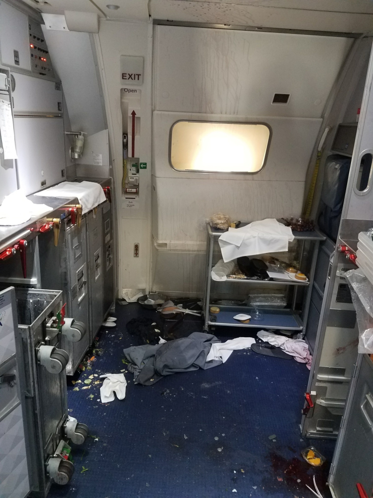 A galley shows the aftermath of a struggle between a passenger and flight attendants on a Delta jet traveling from Seattle to Beijing Thursday.