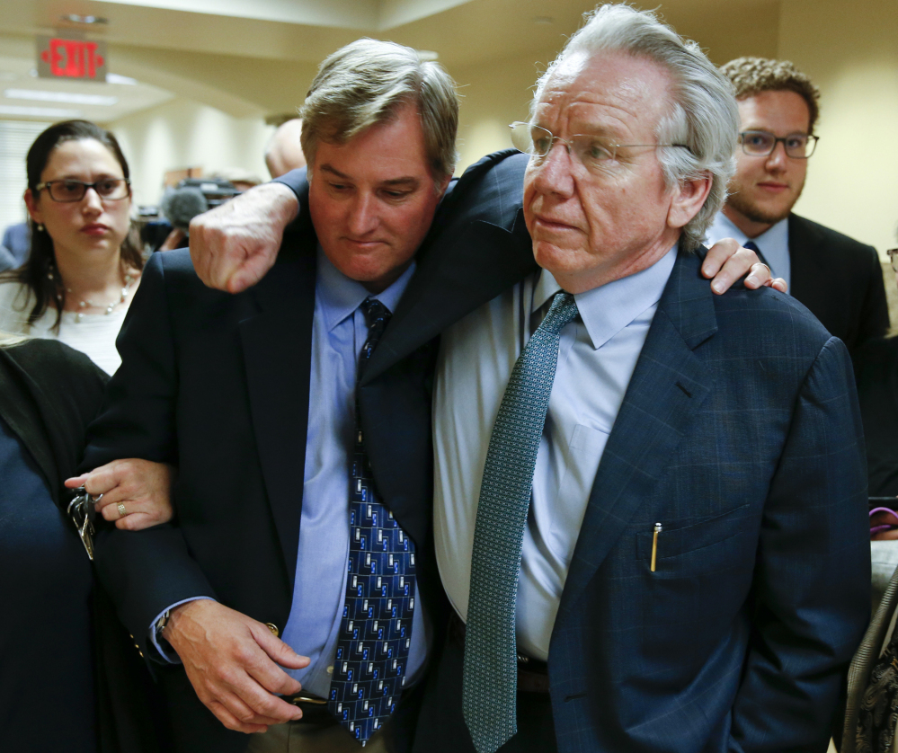 Shannon Kepler, left, a former police officer, celebrates with his attorney, Richard O'Carroll, after a third mistrial was announced Friday in Tulsa, Okla., in Kepler's fatal shooting of his daughter's black boyfriend.