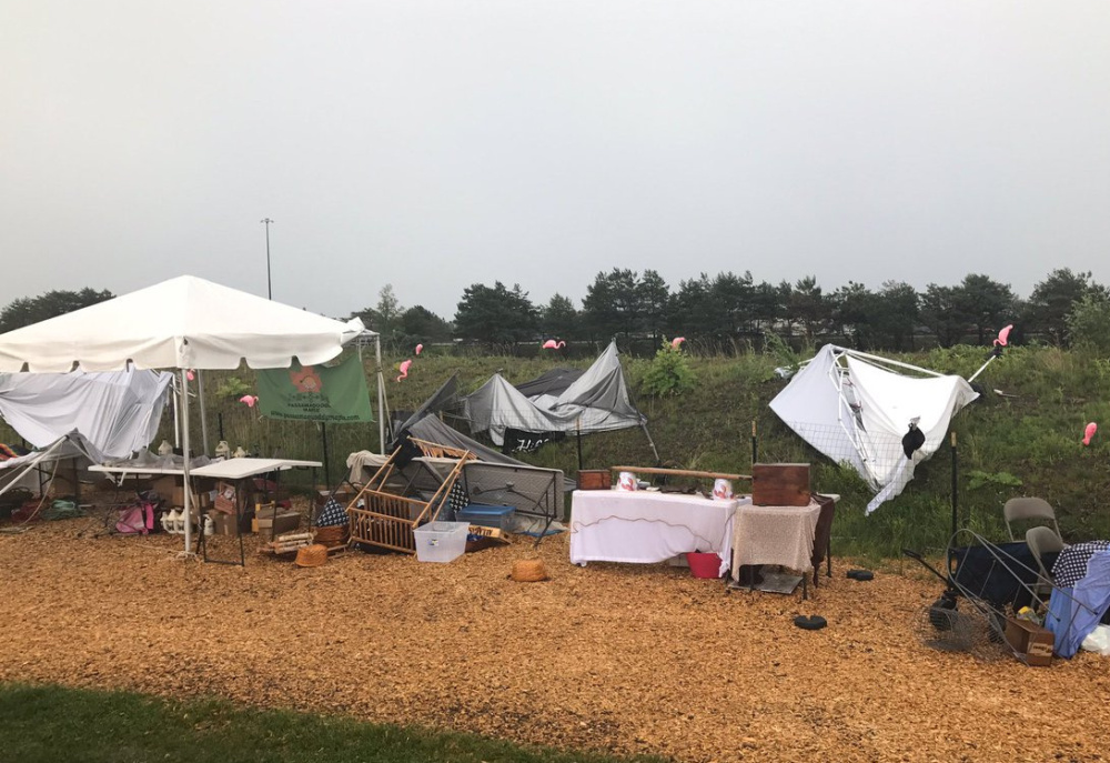 A fierce thunderstorm hit the Down East lobster roll festival Saturday at Thompson's Point in Portland.