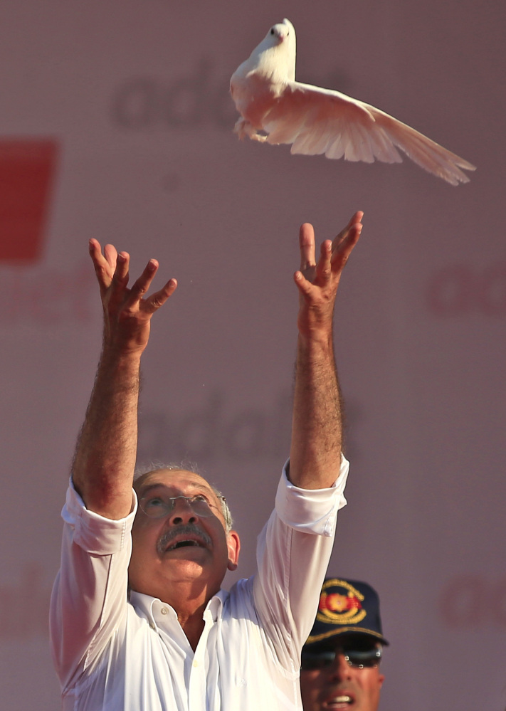 Kemal Kilicdaroglu, the leader of Turkey's main opposition Republican People's Party, throws a dove into the air during a rally following his 425-kilometer (265-mile) 'March for Justice' in Istanbul, Sunday, July 9, 2017. Kilicdaroglu along with thousands of supporters walked from the capital Ankara to an Istanbul prison, began to denounce the imprisonment of a party lawmaker but has grown into a wider protest of Turkey's President Recep Tayyip Erdogan's policies and the large-scale government crackdown on opponents in the wake of July 2016's failed coup attempt. (AP Photo/Lefteris Pitarakis)