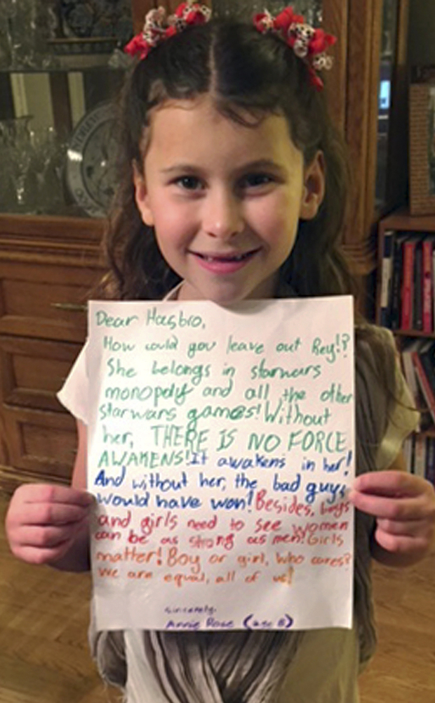Annie Rose, 8, holds a letter she wrote to Hasbro in 2016 asking why Rey was omitted from a game based on