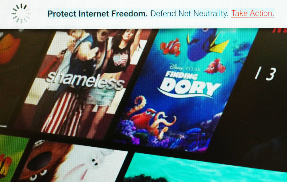 A banner, top, on the Netflix website defends net neutrality, which bars internet service providers from playing favorites with websites and apps. On Wednesday, Netflix joined other tech firms and internet activists in an online show of support for the principle.