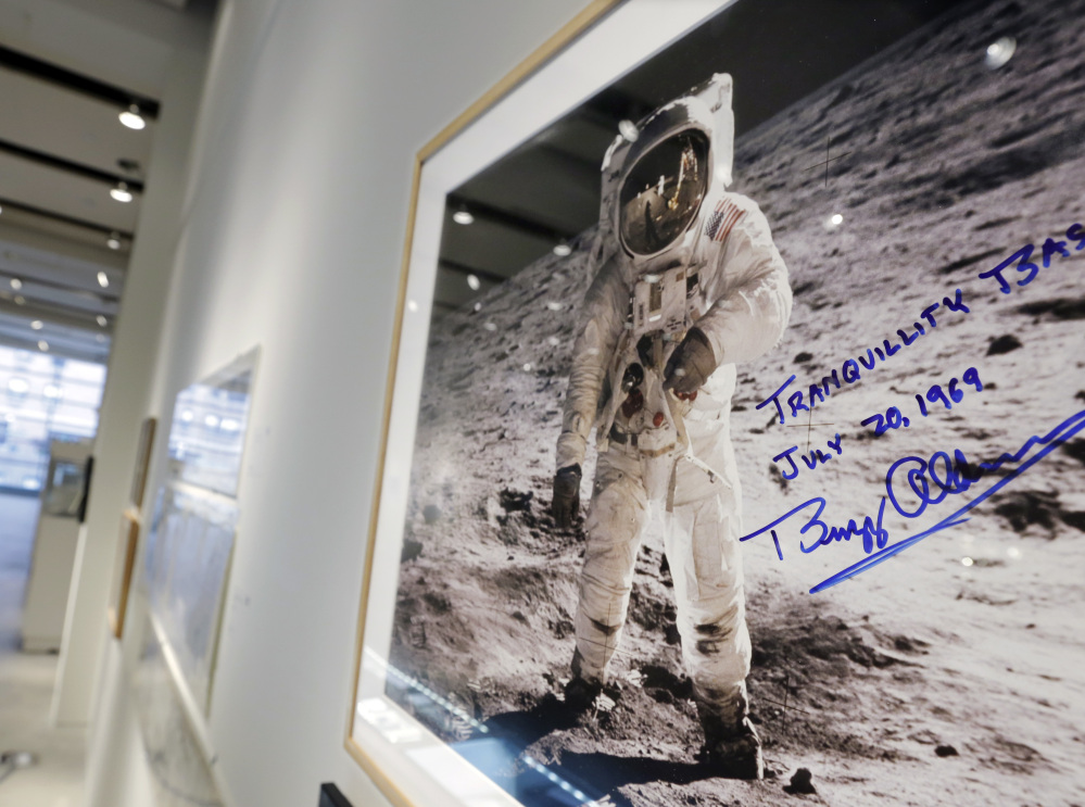 A print of astronaut Neil Armstrong's photograph of Apollo 11 astronaut Buzz Aldrin standing on the moon, to be offered at auction at Sotheby's, is displayed in New York.
