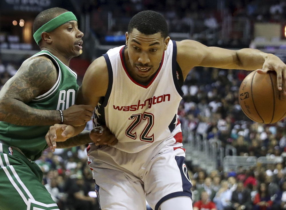 FILE - In this May 4, 2017 file photo, Washington Wizards forward Otto Porter Jr. (22) drives against Boston Celtics guard Isaiah Thomas (4) during the first half in Game 3 of a second-round NBA playoff series basketball game in Washington. The Washington Wizards have matched the Brooklyn Nets' $106 million, four-year offer sheet to keep forward Otto Porter.  (AP Photo/Andrew Harnik, File)