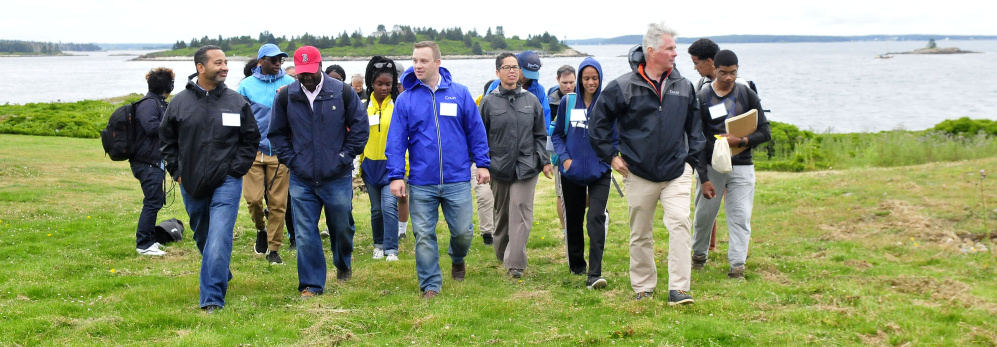 Colby College President David Greene and incoming Colby students walk on the Up East Inc. foundation grounds Thursday on the Wyeth family's Allen Island. The group of students spent a week on the island learning to use equipment to monitor marine ecology.