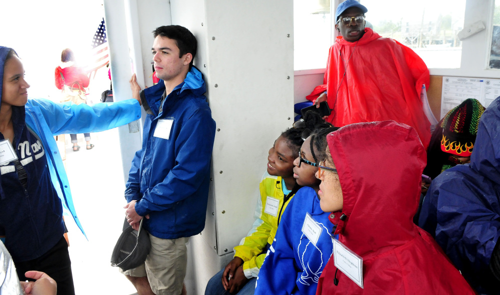 Incoming Colby College students relax on a boat that returned them to Port Clyde on Thursday after a week of studying marine ecology on Allen Island.
