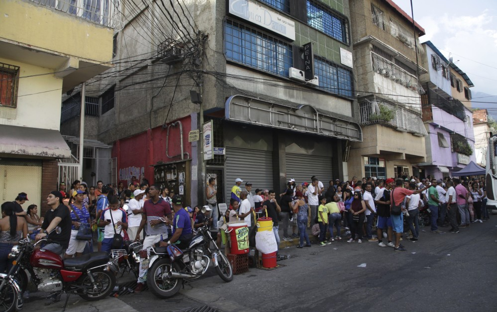 Opposition members line up at a polling station Sunday during a symbolic referendum in Caracas, Venezuela. Venezuela's opposition called for a massive turnout Sunday in a symbolic rejection of President Nicolas Maduro's plan to rewrite the constitution.