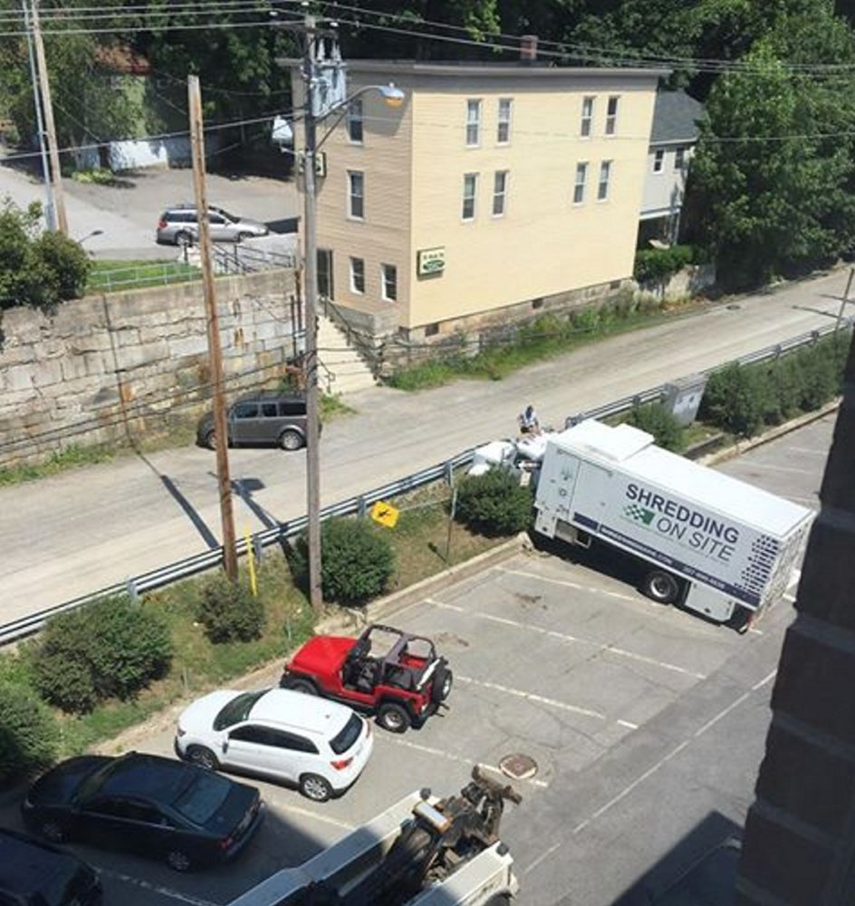 A Shredding On Site truck rolled across the street and into a concrete wall Monday morning in Augusta.