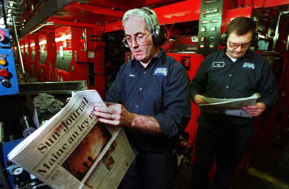 As this photo from the 1998 ice storm indicates, the Portland Press Herald and the Sun Journal in Lewiston have long helped each other out under dire circumstances. Here, one-time assistant foreman Steve Brown, left, and press operator Ray Maxwell Jr. look over early copies of the Sun Journal that were being printed at the Portland paper's plant in South Portland. Power outages in Lewiston and much of central Maine had forced the publication to seek alternative printing sources.