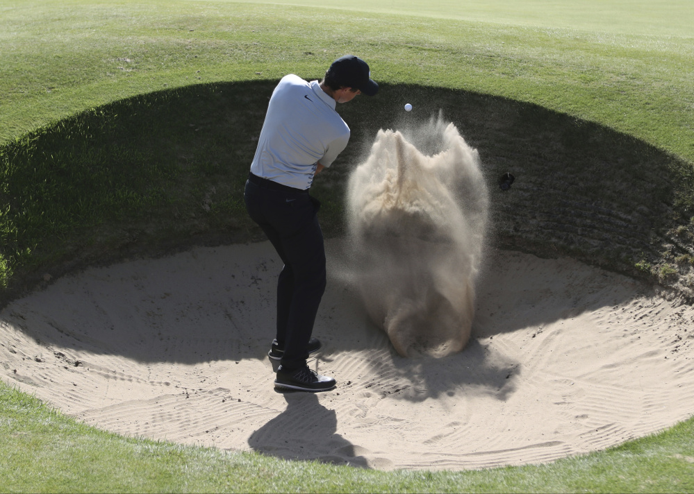 Rory McIlroy, shown playing out of a bunker on the sixth hole during a Tuesday practice round at Royal Birkdale, has seen his game go seriously off course since 2015 when he was inarguably the world's best golfer. A rib fracture early this year added to his problems.