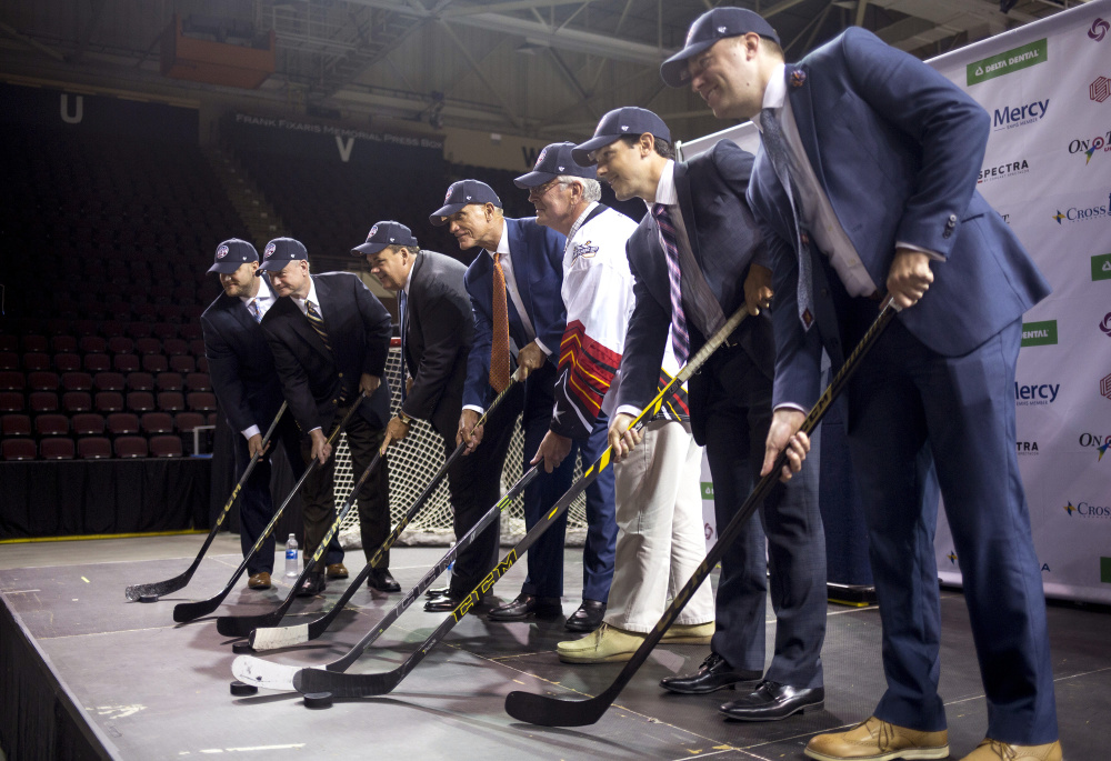 Officials from the ECHL and Cross Insurance Arena pose after a news conference Thursday at the arena, where they announced plans for Portland's new pro hockey franchise.