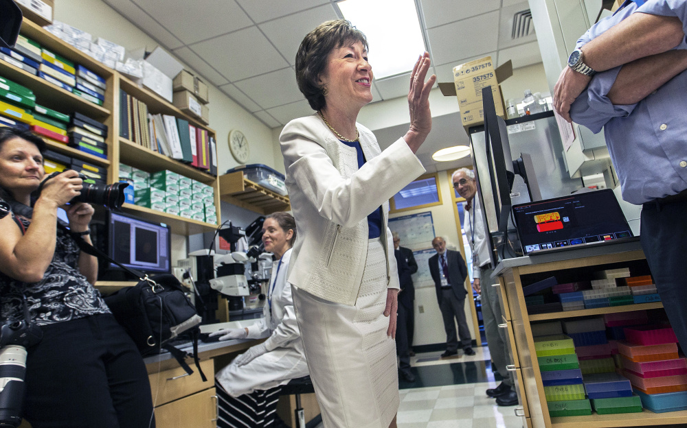 U.S. Sen. Susan Collins of Maine visits the Maine Medical Center Research Institute in Scarborough on Friday. She said the Senate health care bill would have devastating effects.
