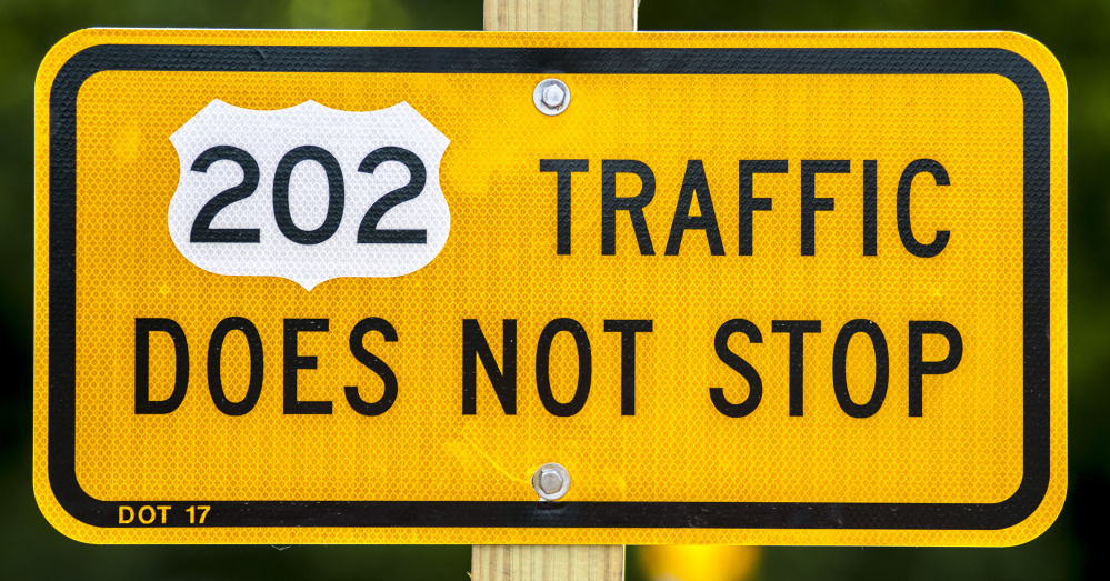 Signs at the intersection of Main Street and U.S. Route 202 on Friday in Winthrop remind drivers on Main Street that the highway traffic doesn't stop.