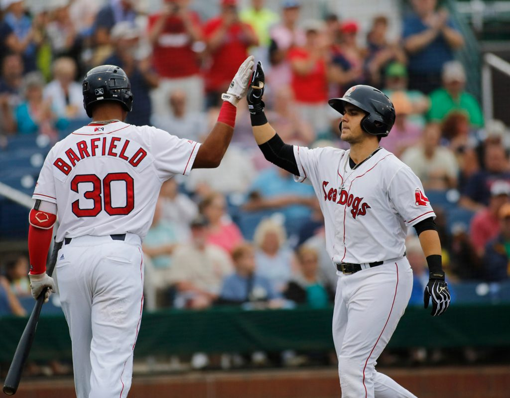 Michael Chavis of the Sea Dogs, right, celebrates with teammate Jeremy Barfield after hitting a home run on July 17 at Hadlock Field. He hit 14 home runs in 67 games with Portland.