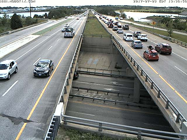 Southbound traffic on Interstate 295 is down to one lane, and cars are backed up for over a mile.  Maine Turnpike photo