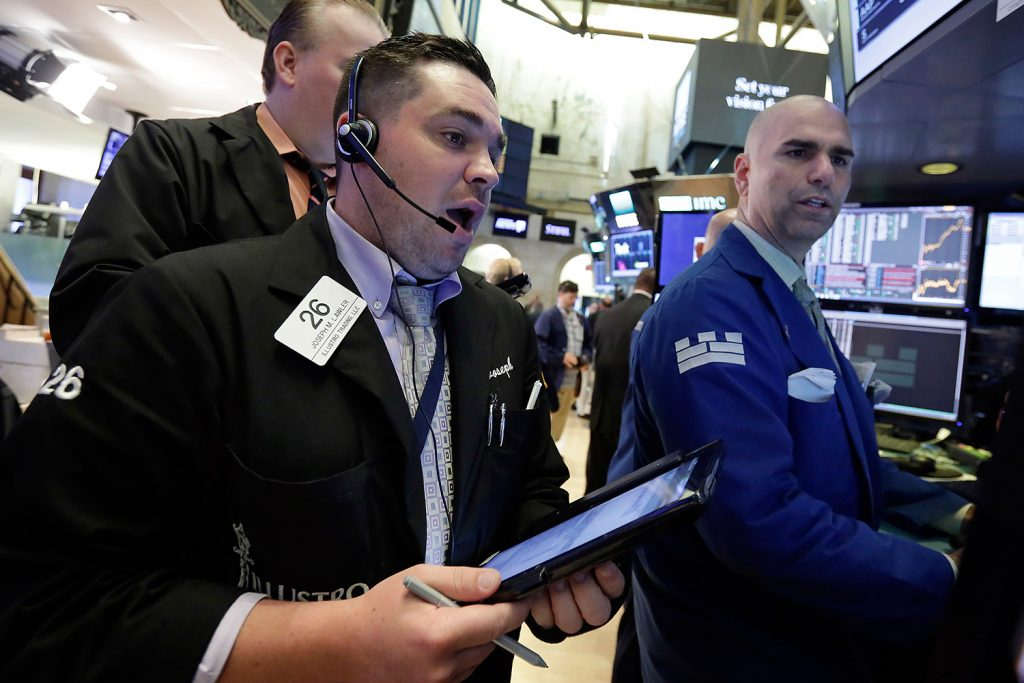 Trader Joseph Lawler, left, and specialist Philip Finale work on the floor of the New York Stock Exchange on Monday.