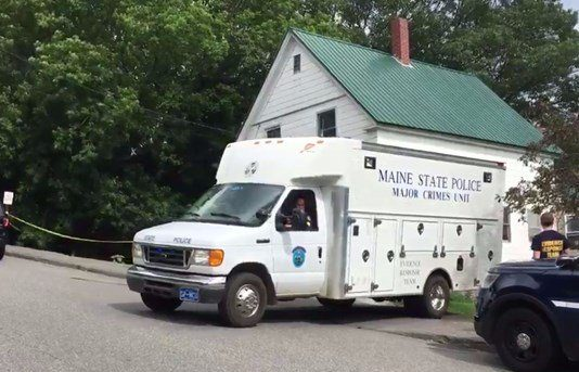 A Maine State Police crime unit vehicle on the scene of a residence in Jay where the body of Wendy Douglass, 51, was found.