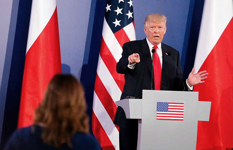 President Trump takes part in a joint news conference with Polish President Andrzej Duda in Warsaw Thursday. The event marked the first time Trump has taken questions during an overseas trip.