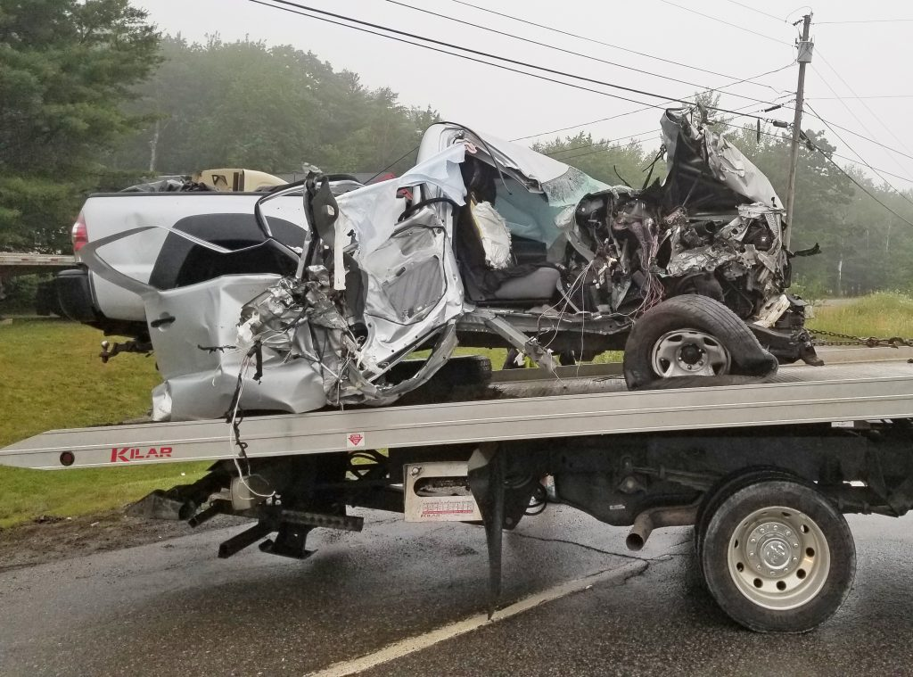 Brandon Bezio was behind the wheel of this  2011 Toyota Tacoma pickup truck when it struck a tractor-trailer head on Saturday in Damariscotta. Bezio was uninjured but a female passenger was ejected from the truck and received severe injuries, according to the sheriff's office.