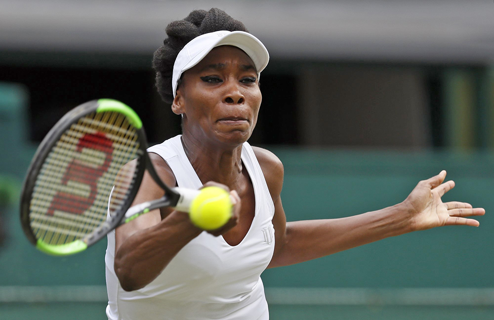 Venus Williams returns a volley to Croatia's Ana Konjuh during their women's singles match at Wimbledon Monday.