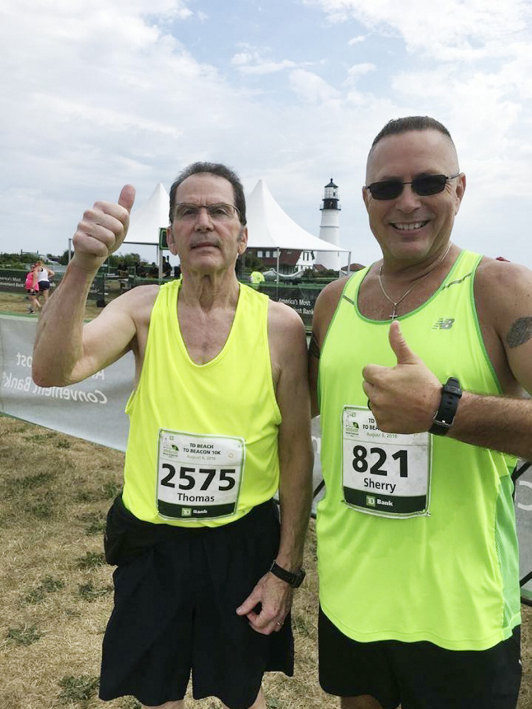 Tom and Shawn Carll ran in last year's Beach to Beacon 10K, with Shawn wearing the race bib that belonged to his mother, Sherry Carll.