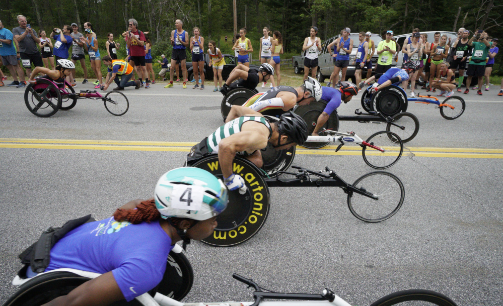 Wheelchair racers pull away from the starting line at the 20th TD Beach to Beacon 10K road race in Cape Elizabeth on Saturday. (Staff Photo by Gregory Rec/Staff Photographer)