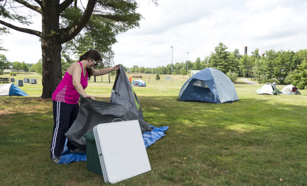 Amanda Jones of Shrewsbury, Pa., sets up a ground cloth Friday where she intends to spend the week camping on the Colby College campus in Waterville during the Appalachian Trail Conservancy Conference.
