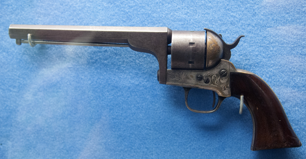 A pistol believed to have belonged to Army Maj. Gen. Joshua Chamberlain, a Civil War veteran, is part of the collection seen on a tour Thursday at the Maine Military Historical Society's museum at Camp Keyes in Augusta.