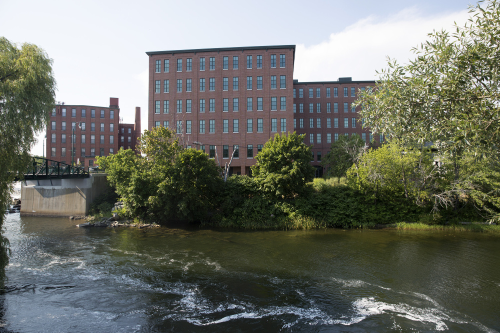 Maine Medical Center plans to move about 500 workers by the end of the year to the largest building in downtown Westbrook, One Riverfront Plaza, seen in the background across the Presumpscot River. That has sparked additional small-business activity in the city.