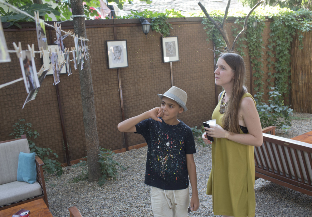 'Little Picasso,' a 10-year-old Afghan migrant, exhibits works to benefit Serbian boy