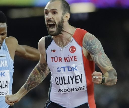 Turkey's Ramil Guliyev celebrates after his surprise victory Thursday in the men's 200-meter final at the world track and field championships in London.
