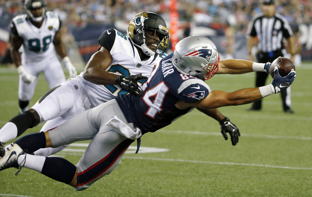 Patriots wide receiver Austin Carr stretches for a catch in front of Jaguars cornerback Doran Grant in the second half of Thursday night's game in Foxborough, Mass.