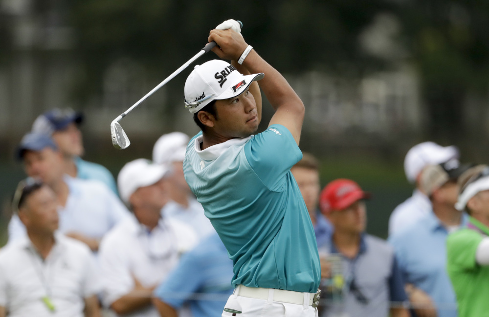 Hideki Matsuyama watches his tee shot on the 17th hole during the second round of the PGA Championship at the Quail Hollow Club in Charlotte, N.C. Matsuyama shot a 7-under 64 to move into a tie for the lead with Kevin Kisner at 8 under.