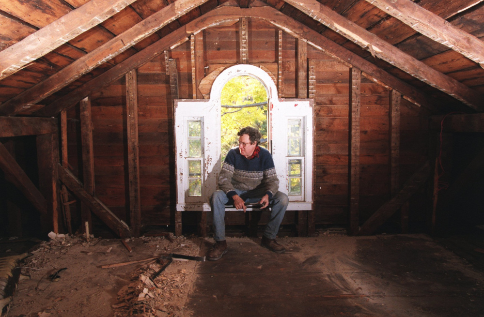 In this Oct. 20, 1997 photo, Chandler Saint ponders the daunting task of restoring the attic study of the Beecher House in Litchfield, Conn. Taken apart and stored in pieces, the house where Harriet Beecher Stowe grew up is for sale on eBay, with an asking price of $400,000. Museums passed on the building, and the owner went to the online auction site after finding no takers on Craigslist.