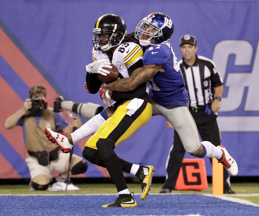Cobi Hamilton of the visiting Pittsburgh Steelers pulls in a touchdown pass while defended by Valentino Blake of the New York Giants during the second quarter of Pittsburgh's 20-12 victory in an exhibition opener Friday night.