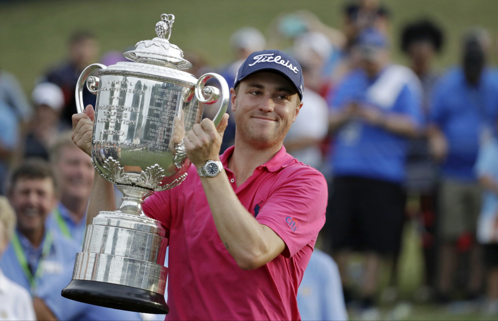Justin Thomas poses with the Wanamaker Trophy after winning the PGA Championship on Sunday at Quail Hollow Club Sunday in Charlotte, N.C.