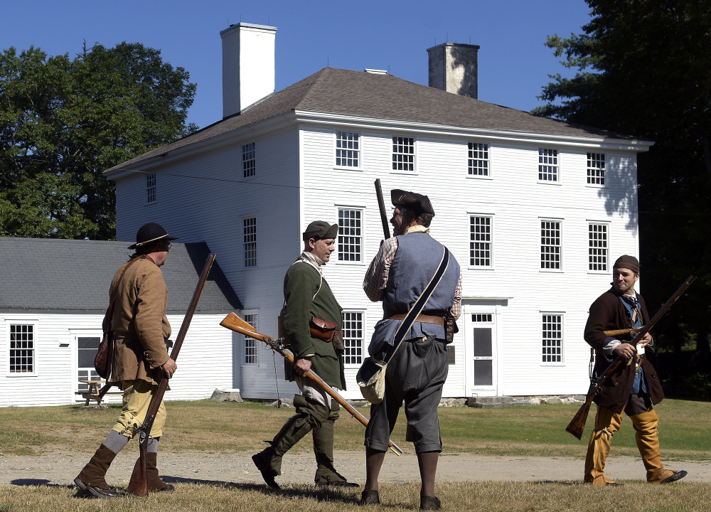 Eighteenth-century scouts gather at the Pownalborough Court House on Sunday in Dresden. Re-enactors played militiamen patrolling for natives during the French and Indian War.