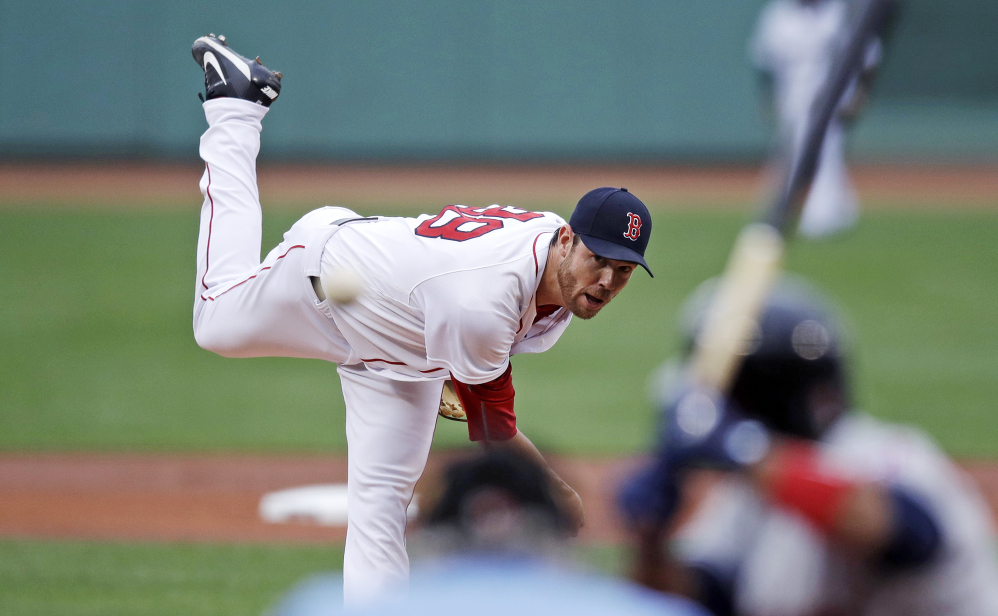 Red Sox starting pitcher Doug Fister delivers during the first inning against the Cleveland Indians Monday.