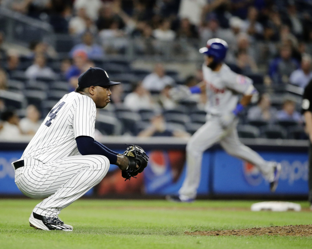 Yankees closer Aroldis Chapman reacts as Amed Rosario of the Mets runs the bases after hitting a two-run homer off Chapman in the ninth inning Tuesday. The Yankees held on to win, 5-4.
