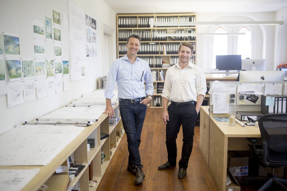 Matthew O'Malia, left, founder of GO Logic, left, and Joshua Henry, a partner in GO Lab, pose for a portrait in their Belfast office building. GO Logic is a high-performance home builder working to develop a wood-based insulation board. It recently launched GO Lab to spearhead research and development.