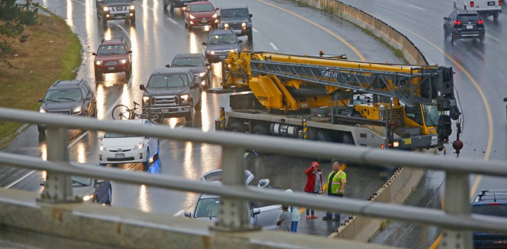 Traffic is slowed in both directions after a crane crashed in the southbound lane just south of Tukey's Bridge on Interstate 295 in Portland on Friday afternoon.