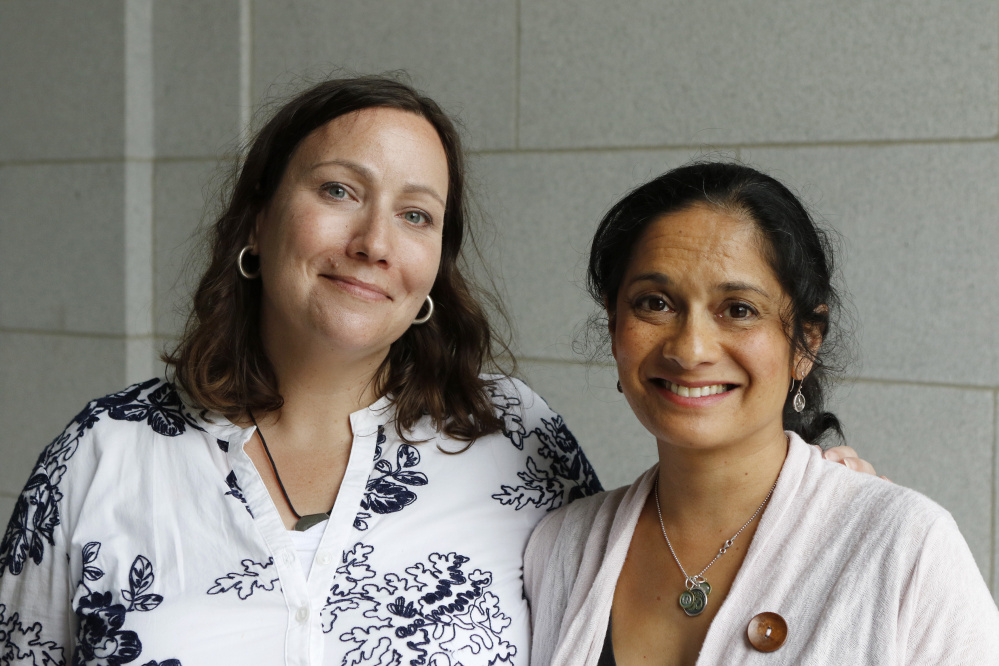 Marie Follayttar Smith, left, and Dini Merz of Mainers for Accountable Leadership. The group has drawn attention to a campaign that helps people leave white supremacy groups. Staff photo by Joel Page