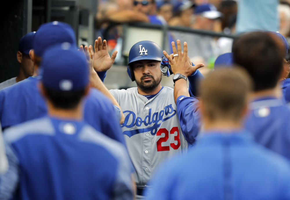 Adrian Gonzalez celebrates after scoring against Detroit in the second inning of the Dodgers 8-5 road victory Friday night. Gonzalez doubled in first at-bat since June 11