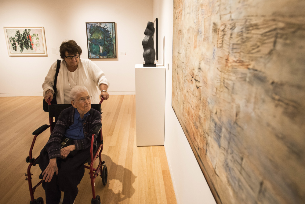 Marion Colby pushes the oldest living member of the Colby clan, Alice Dickinson, 97, during a tour of the Colby College Museum of Art in Waterville on Saturday.
