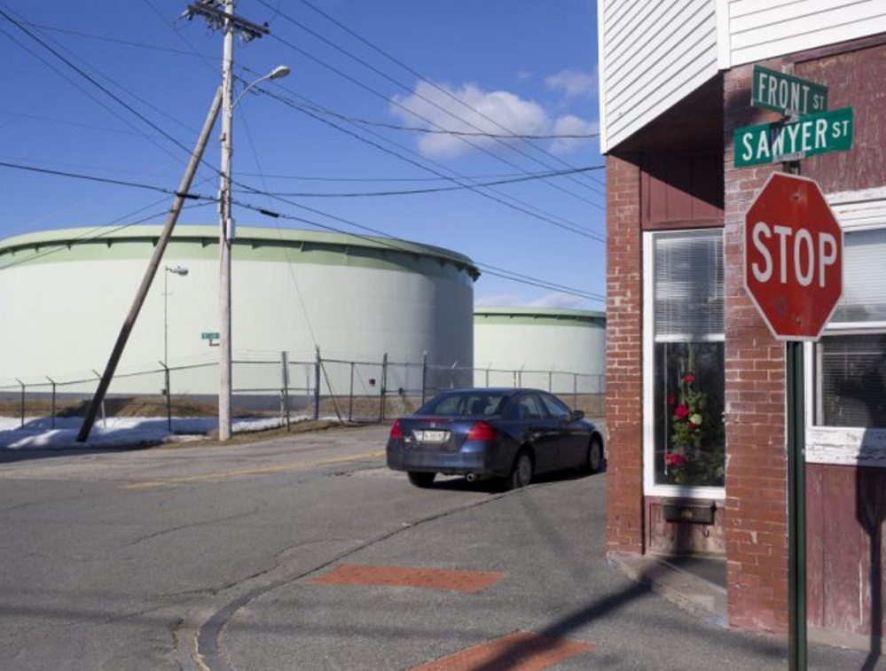 At right, a Portland Pipe Line Corp. tank in South Portland. A judge said Friday that the firm's