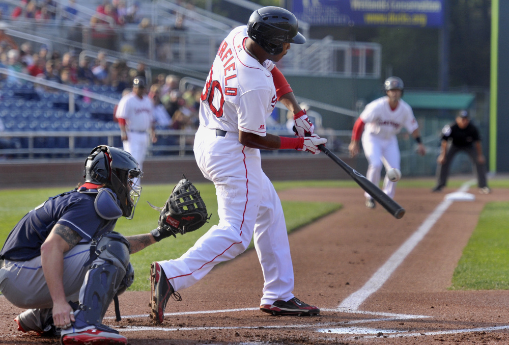 Jeremy Barfield of the Sea Dogs connects for an RBI single that drove in Chad De La Guerra from third base in Game 1 of a doubleheader Friday night against the Binghamton Rumble Ponies. The Sea Dogs won the opener but lost Game 2.