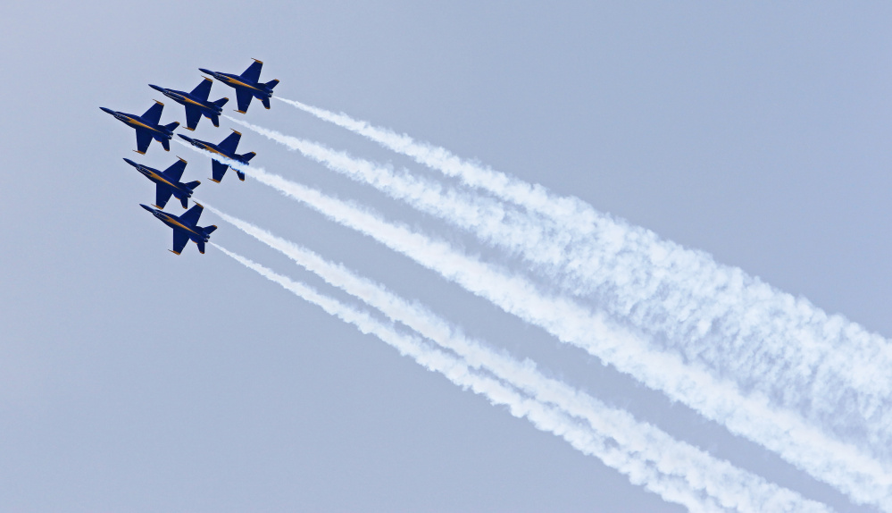 The U.S. Navy Blue Angels stay in steady formation at the Great State of Maine Air Show at Brunswick Executive Airport. The event continues Sunday.